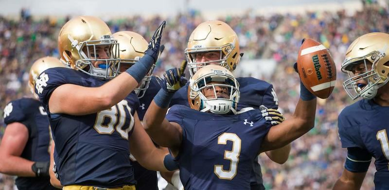 Notre Dame football players celebrating after a score