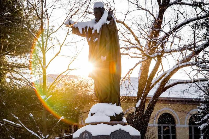 Sacred Heart Jesus statue on a winter morning